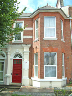 External photograph of one of our properties with a red door