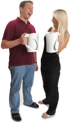 Photo of two tenants, each holding up a kettle